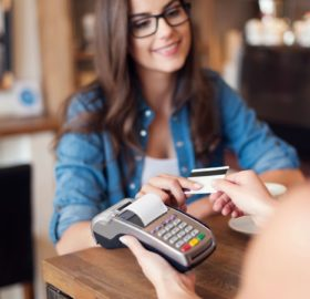 Woman using debit card